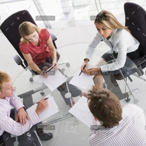 demo-attachment-458-four-businesspeople-in-a-boardroom-with-paperwork-PC4V8H4